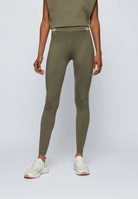BOSS - ERINA - Leggings - Trousers - dark green - 0