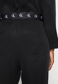 Calvin Klein Jeans - TAPERED UTILITY  - Jumpsuit - black - 4
