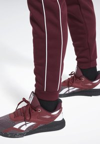 Reebok - WORKOUT READY JOGGERS - Tracksuit bottoms - burgundy - 3