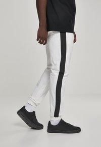 Urban Classics - Tracksuit bottoms - white, black - 3