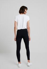 Calvin Klein Jeans - MONOGRAM TAPE MILANO - Leggings - Trousers - ck black/ bright white - 2