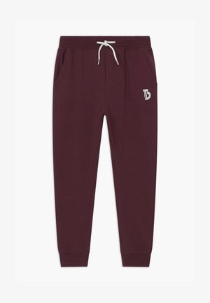 MELO - Tracksuit bottoms - red