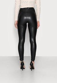 ONLY Petite - ONLZABO BUTTON - Leggings - Trousers - black - 2