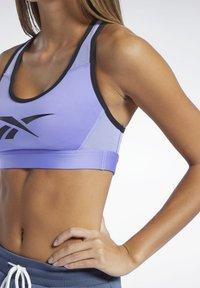 Reebok - REEBOK LUX RACER MEDIUM-IMPACT SPORTS BRA - Medium support sports bra - lilac - 3