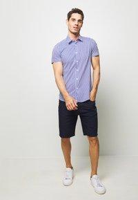 Benetton - BASIC CHINO - Shorts - dark blue - 1