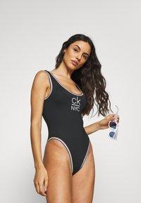 Calvin Klein Swimwear - PRIDE EDIT SCOOP ONE PIECE - Bañador - black - 1