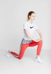 Nike Performance - DRY TEE CREW - Print T-shirt - white/black - 1