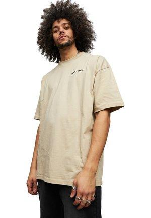 T-shirt med print - beige