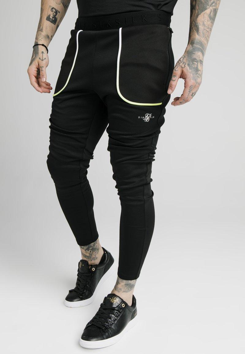 SIKSILK - LEGACY FADE TRACK PANTS - Tracksuit bottoms - black