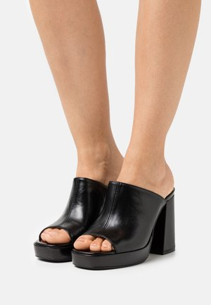 Heeled mules - black poncho
