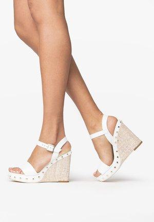 High heeled sandals - bianco