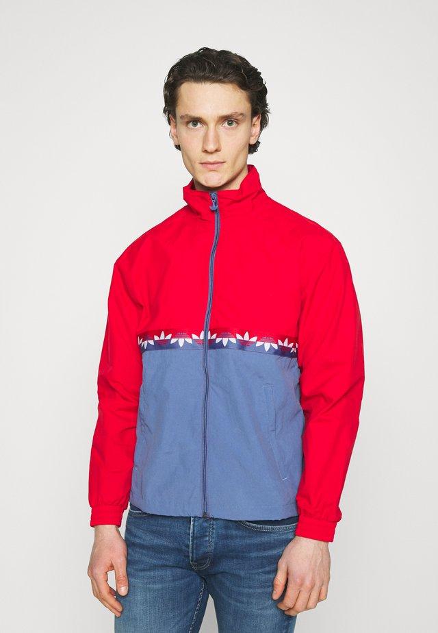 SLICE - Training jacket - crew blue/scarlet