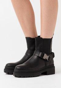 Even&Odd - Cowboy/biker ankle boot - black - 0