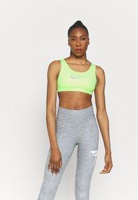Nike Performance - BRA - Medium support sports bra - lime glow/barely green - 0