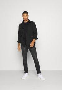 Calvin Klein - RINGER POCKET - T-shirt print - black - 1