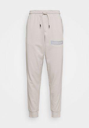 PANT - Tracksuit bottoms - beige