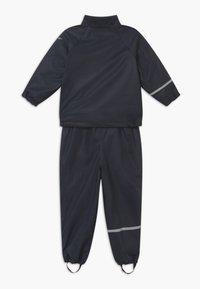 CeLaVi - RAINWEAR SET UNISEX - Pantalones impermeables - navy - 2