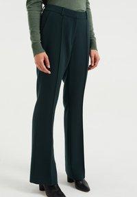 WE Fashion - Trousers - moss green - 3