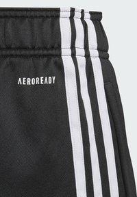 adidas Performance - STRIPES AEROREADY PRIMEBLUE JOGGERS - Verryttelyhousut - black - 2