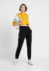 Hollister Co. - Teplákové kalhoty - black - 1