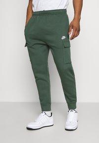 Nike Sportswear - CLUB PANT - Cargo trousers - galactic jade/galactic jade/white - 0
