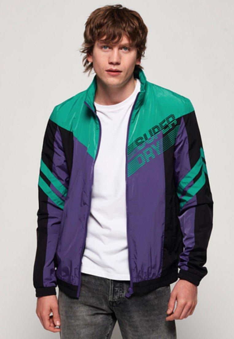 Men OFF-PISTE-VERRYTTELYTAKKI - Training jacket