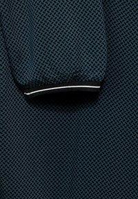 Cecil - BLUSE MIT MINIMAL PRINT - Long sleeved top - dark green - 4
