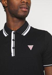 Guess - SCOTT - Polo shirt - jet black - 5