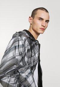Emporio Armani - BLOUSON JACKET - Waterproof jacket - grey - 5