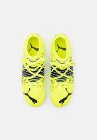 Puma - FUTURE Z 2.1 FG/AG JR UNISEX - Moulded stud football boots - yellow alert/black/white - 3
