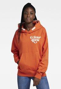 G-Star - PREMIUM CORE OVERSIZED HDD SW - UNISEX - Hoodie - acid orange - 1