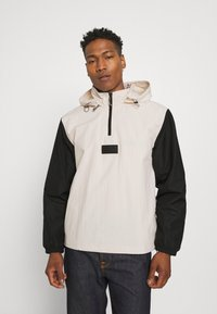 adidas Originals - UNISEX - Windbreaker - halo ivory/black - 0