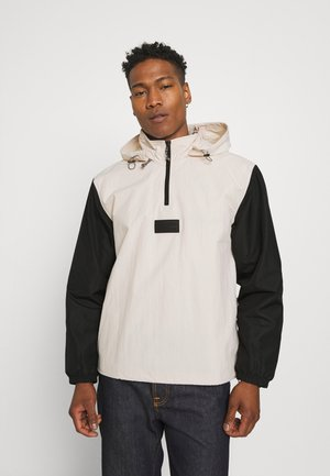 UNISEX - Windbreaker - halo ivory/black