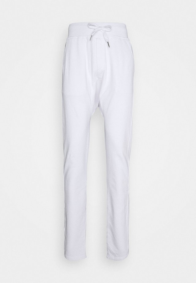 PAUL - Tracksuit bottoms - white