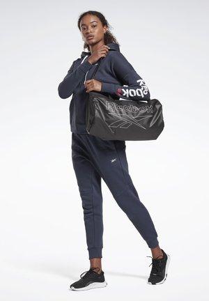 ESSENTIALS CYLINDER BAG - Sports bag - black