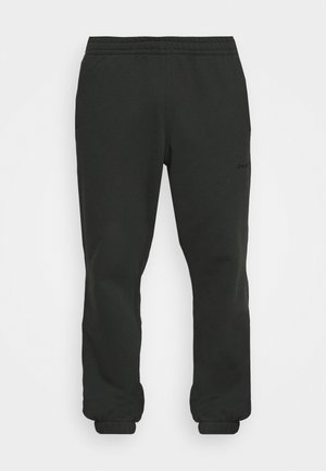 BASICS UNISEX - Tracksuit bottoms - black