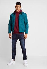 Burton Menswear London - RINSE TRIM - Slim fit jeans - dark blue - 1