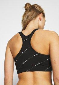 Champion - BRA LEGACY - Medium support sports bra - black - 5