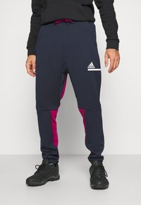 adidas Performance - SPORTSWEAR AEROREADY PANTS - Jogginghose - legend ink/power berry - 0