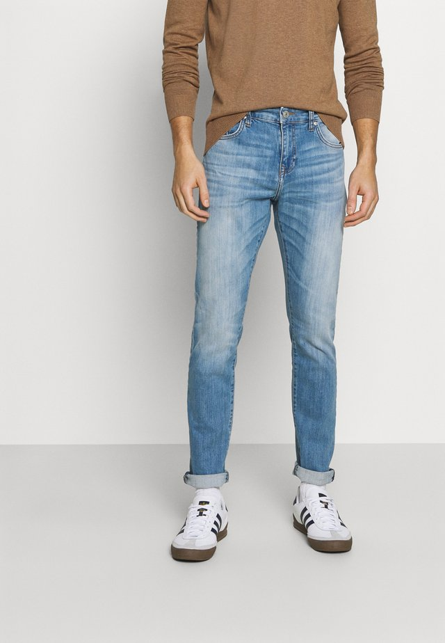 JOSHUA - Slim fit jeans - mute wash