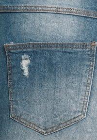 JDY - FLORA - Flared jeans - medium blue denim - 2