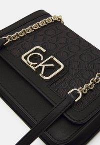 Calvin Klein - FLAP SHOULDER BAG - Across body bag - black - 4