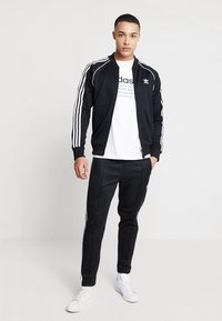 adidas Originals - SUPERSTAR ADICOLOR SPORT INSPIRED TRACK TOP - Trainingsvest - black - 1