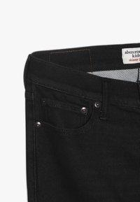 Abercrombie & Fitch - SKINNY - Slim fit jeans - black - 2