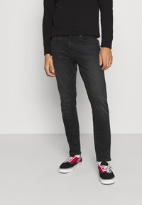 Tommy Jeans - AUSTIN UNISEX - Jeans Tapered Fit - max black - 0