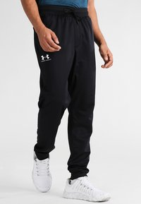 Under Armour - SPORTSTYLE - Tracksuit bottoms - black - 0