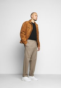 Jack´s Sportswear - CROPPED LOOSE FIT PANTS - Trousers - sand - 1
