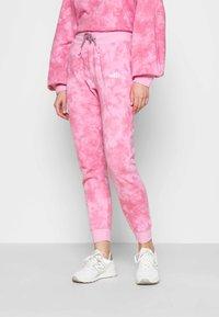 Ellesse - LORIOR - Tracksuit bottoms - pink - 0
