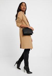 Gina Tricot - MIA BAG - Across body bag - mottled black - 1
