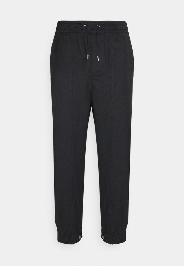 SERGE - Pantalon de survêtement - black